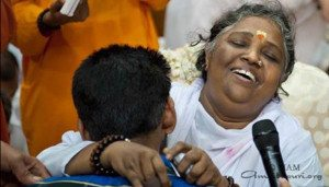 WEB-p16-17_Amm giving darshan