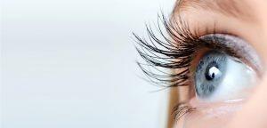 Female eye with long eyelashes close up