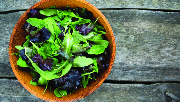 46810764 - fresh green salad mix in a wooden bowl